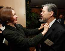 Patricia adjusts Joe's tie