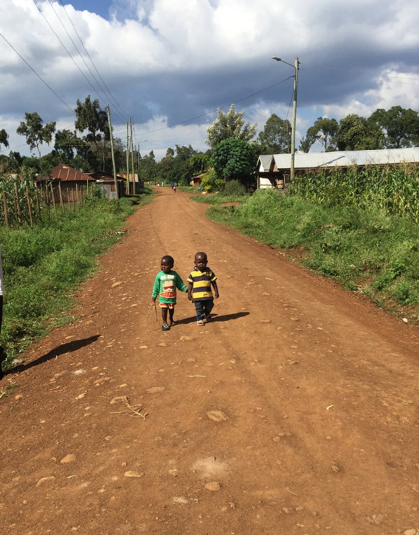 Two young boys on a street in Kisumu